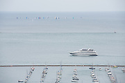 Cruise boat and sailboats on Lake Michigan and Monroe Harbor in Chicago, Illinois. Photo by Mark Black