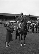 """07/08/1980<br /> 08/07/1980<br /> 07 August 1980<br /> R.D.S. Horse Show: John Player Top Score Competition, Ballsbridge, Dublin.  Harvey Smith (Great Britain) winner, on """"Sanyo Music Centre"""" receiving the John Player Lance from Mrs Oliver Casey, wife of the Managing Director John Player."""