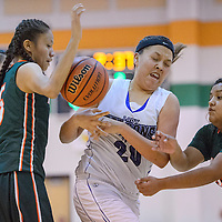 Shiprock Northwest Falcon Miah Willie (20) loses a rebound to Wingate Bears Ariel Brown (33) and Brittany Bruce (5) Thursday at Wingate High School.