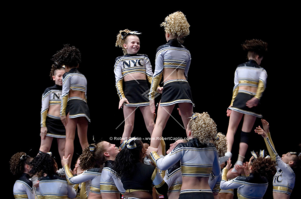 The NY Cheer Jr. Gold compete in the NCA/NDA U.S. Championship held at the Hammerstein Ballroom Sat. March 10, 2007. Rising popularity in the sport of cheerleading has brought a significant increase in cheerleading related accidents and injuries.