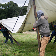 Another tent goes up in the wind . The Protect Pont Valley Campaign camp. Nee More Coal action in the Pont Valley. Climate activists dressed in red entered the Banks Group open cast coal mine Bradley site in Pont Valley early morning. The site was not operating and stayed closed for the day. The action was part of a peaceful mass demonstration by local actvists and climate protectors.