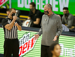 Feb 13, 2021; Berkeley, California, USA; Colorado Buffaloes head coach Tad Boyle, right, disputes a call with an official during the first half of an NCAA basketball game against the California Golden Bears at Haas Pavilion. Mandatory Credit: D. Ross Cameron-USA TODAY Sports