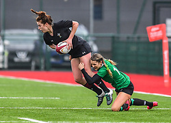 Wales women's Lisa Neumann is tackled by Ireland women's Megan Williams<br /> <br /> Photographer Craig Thomas/Replay Images<br /> <br /> International Friendly - Wales women v Ireland women - Sunday 21th January 2018 - CCB Centre for Sporting Excellence - Ystrad Mynach<br /> <br /> World Copyright © Replay Images . All rights reserved. info@replayimages.co.uk - http://replayimages.co.uk