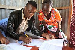 Paul Myongesa registers visitors at the ANC outreach clinic .. SAHFA baseline survey visit to Angiya, Homa Bay County, Kenya.  SAHFA Kenya © April 2019