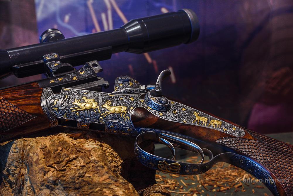 Ferlach, Jagd und Büchsenmachermuseum. Traditional rifles engraved with gold decorations.