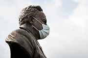statue bust with protective mediacal face mask