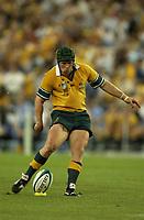 Photo: Richard Lane.<br />New Zealand v Australia. Semi-Final, at the Telstra Stadium, Sydney. RWC 2003. 15/11/2003. <br />Elton Flatley kicks.