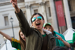 London, March 13th 2016. The annual St Patrick's Day Festival takes place in Trafalgar Square with performances on stage and plenty of Irish food and drink for the thousands of revellers.  PICTURED: A young woman cheers as the Craicheads perform. ©Paul Davey<br /> FOR LICENCING CONTACT: Paul Davey +44 (0) 7966 016 296 paul@pauldaveycreative.co.uk