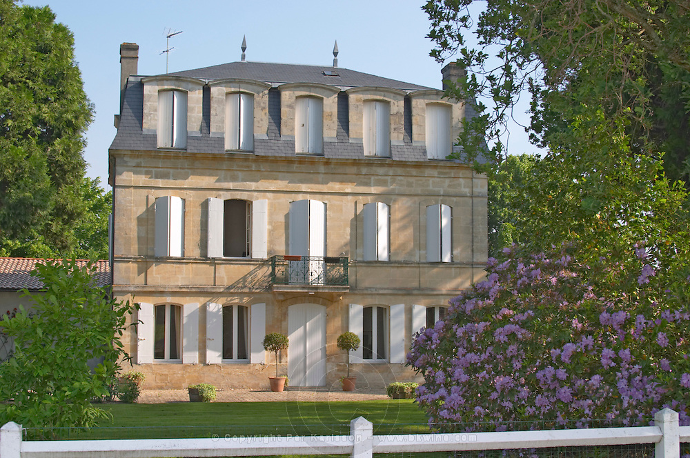 The chateaux building, window shutters some open some closed and garden Chateau Paloumey Haut-Medoc Ludon Medoc Bordeaux Gironde Aquitaine France