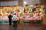 Butcher's stall in historic market building in Triana, Seville, Spain