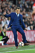 England women's manager Phil Neville kicks the ball during the FIFA Women's World Cup UEFA Qualifier match between England Ladies and Wales Women at the St Mary's Stadium, Southampton, England on 6 April 2018. Picture by Graham Hunt.