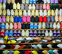 FEZ, MOROCCO - CIRCA MAY 2018: Typical store of traditional Moroccan shoes in the  Medina in Fez. Fes el Bali. is the oldest walled part of Fez, Morocco.