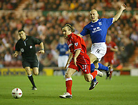 Photo. Andrew Unwin.<br /> Middlesbrough v Everton, Carling Cup Fourth Round, Riverside Stadium, Middlesbrough 03/12/2003.<br /> Middlesbrough's Bolo Zenden (c) goes past Everton's Wayne Rooney (r).