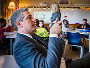 """08 APRIL 2019 - DES MOINES, IOWA: Rep. TIM RYAN uses his smart phone to take a picture during a classroom visit at Callanan Middle School. Ryan, a candidate for the Democratic ticket of the US presidency, visited Callanan Middle School in Des Moines to discuss education issues. Ryan declared his candidacy on the US television show """"The View"""" on April 4. Ryan, 45 years old, represents Ohio's 13th District, which includes Lordstown, where a large General Motors plant recently closed. He is the latest Democrat to announce his candidacy to be the Democratic nominee in the 2020 election. Iowa holds its presidential caucuses on Feb. 3, 2020.      PHOTO BY JACK KURTZ"""
