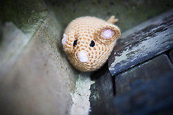 © Licensed to London News Pictures. 27/04/2016. Thirsk UK. Picture shows a knitted mouse in Thirsk that has been Yarn Bombed. Under the cover of Darkness 300 Yarn bombing street artist's have covered the Town centre of Thirsk, the group has covered bollards, flower pots, the bus stop, tree's, benches, even the local police station. The knitted creations took over 750 balls of wool & have been placed along the route of the Tour De Yorkshire which will pass through the town during it's final stage from Middlesborough to Scarborough on Sunday.  Photo credit: Andrew McCaren/LNP