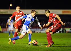 Bristol Rovers' Eliot Richards takes on Crawley Town's Matthew Sadler - Photo mandatory by-line: Seb Daly/JMP - Tel: Mobile: 07966 386802 08/01/2014 - SPORT - FOOTBALL - Broadfield Stadium - Crawley - Crawley Town v Bristol Rovers - FA Cup - Replay