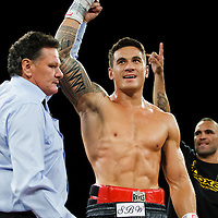 Sonny Bill Williams is declared the winner by referee Lance Revill with Anthony Mundine in background at the New Zealand Heavyweight Belt title boxing fight against Clarence Tillman III from USA, at Claudelands Events Centre, Hamilton, New Zealand, Wednesday 8 February 2012. Photo: Stephen Barker/PHOTOSPORT