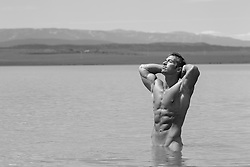 muscular man in a lake