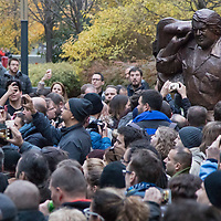 People take photographs of the first ever life-size bronze statue of Italian actor Carlo Pedersoli better known as Bud Spencer inaugurated in Budapest, Hungary on Nov. 11, 2017. ATTILA VOLGYI