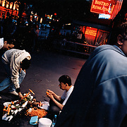 France, Paris, 05-2003..Illegal Chinese Mr Wang, 42, sells carrot carvings in Paris. He is part of a new wave of immigrants from China?s northeast, home to millions of former cradle-to-grave factory workers laid off by closures. ..