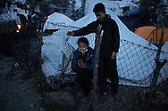 A young woman on her phone in the makeshift camp. About 20000 are living in a makeshift camp nearby the city of Moria on the island of Lesbos in miserable conditions, most of the without water, electricity nor sanitary facilities.  Federico Scoppa