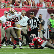 San Francisco 49ers tight end Garrett Celek (88) gets drilled by Tampa Bay Buccaneers free safety Dashon Goldson (38) during an NFL football game between the San Francisco 49ers  and the Tampa Bay Buccaneers on Sunday, December 15, 2013 at Raymond James Stadium in Tampa, Florida.. (Photo/Alex Menendez)