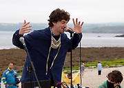 Musician, Cosmo Sheldrake, starts off the Youth Strike for Climate with some music using mostly samples of animal noises as well as his own music. Gyllyngvase beach, Cornwall.  Anna Hatfield/Pathos