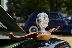 04 August 2012:  Hood ornament, hood mascot, radiator cap or indicator on a 1927 Chevy 1 ton stake box pickup truck shown at the McLean County Antique Automobile Club Show at the David Davis Mansion, Bloomington IL