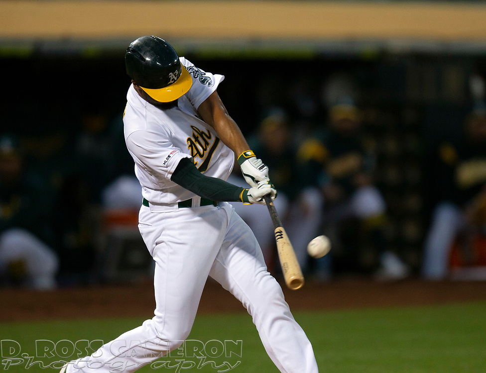 Sep 7, 2019; Oakland, CA, USA; Oakland Athletics Marcus Semien connects for a two-RBI triple against the Detroit Tigers during the fourth inning of a baseball game at Oakland Coliseum. Mandatory Credit: D. Ross Cameron-USA TODAY Sports