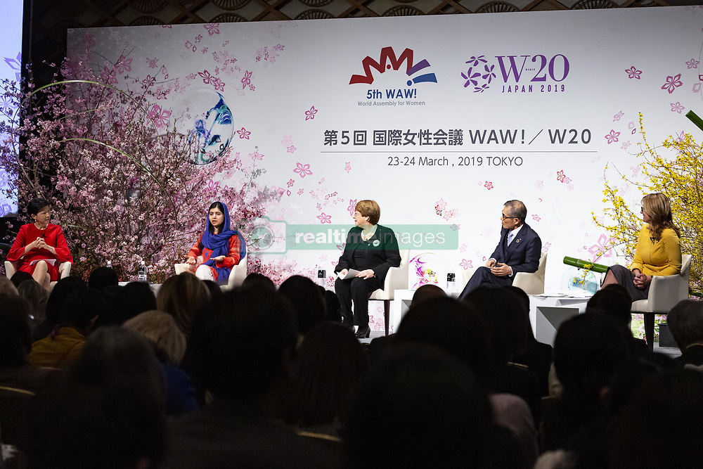 March 23, 2019 - Tokyo, Japan - Nobel Peace Prize laureate Malala Yousafzai (2nd L) and Michelle Bachelet (C) United Nations High Commissioner for Human Rights and former President of Chile, speak duringthe 5th World Assembly for Women (WAW!) in Tokyo. This year the WAW! in collaboration with the Women 20 (W20), one of the G20 engagement groups established to make recommendations to G20, invited female leaders from politics, business and society to discuss the roles of women in their countries and affiliations. The event is held from March 23 to 24 at the Hotel New Otani Tokyo. (Credit Image: © Rodrigo Reyes Marin/ZUMA Wire)