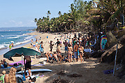 Surfers gather on Puntas beach for a party in Rincon Puerto Rico