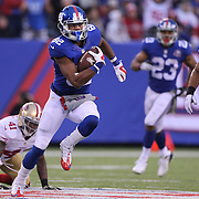 Rueben Randle, New York Giants, avoids the tackle of  Antoine Bethea, San Francisco 49ers, during the New York Giants V San Francisco 49ers, NFL American Football match at MetLife Stadium, East Rutherford, NJ, USA. 16th November 2014. Photo Tim Clayton