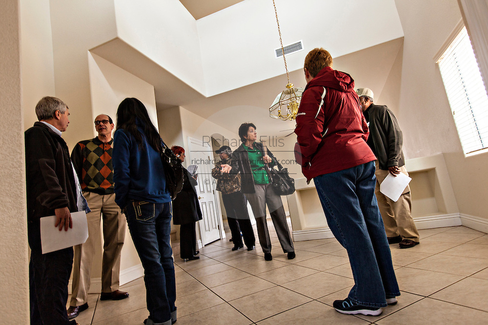 Buyers view a foreclosed home in Las Vegas, NV.