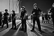 LAPD officers form a line out front of LAPD headquarters, Parker Center, on the first evening of the LA riots. 4/29/1992