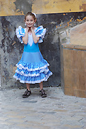 American child gets into the Flamenco tradition during Feria festival, Seville, Spain, April 2008