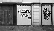 A shop window now filled with closure signs instead of products after having to close its doors due to the economic struggle the Covid-19 pandemic has caused.