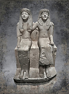Ancient Roman statue of Pendua and his wife Nefertari, limestone, New Kingdom, 19th Dynasty, (1292-1186 BC),  Deir-el-Medina, Thebes. Egyptian Museum, Turin. <br /> <br />  Carved in Thebian white limestone the statue of Pendua and his wife Nefertari shows the skill and attention to details of the sculptors of Deir-el-Medina, the worker's village of those who built the Royal Tombs at Thebes. The theme of the family is echoed by a carving of a daughter between the two figures.