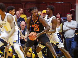 Jan 12, 2019; Morgantown, WV, USA; Oklahoma State Cowboys forward Kentrevious Jones (00) dribbles in the lane during the second half against the West Virginia Mountaineers at WVU Coliseum. Mandatory Credit: Ben Queen-USA TODAY Sports