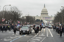The limousine carrying President Donald Trump and First Lady Melania Trump drives in the inaugural parade after Trump was sworn-in as the 45th President in Washington, D.C. on January 20, 2017. Photo by Kevin Dietsch/UPI