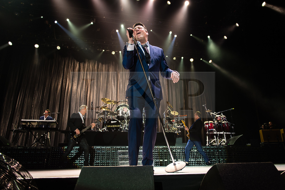 © Licensed to London News Pictures. 17/03/2015. London, UK.   Spandau Ballet performing live at The O2 Arena.   In this picture - Tony Hadley (centre), Martin Kemp (left), Gary Kemp (right). Spandau Ballet are a British new wave band formed in London in the late 1970s, composed of members Tony Hadley (lead vocals, synthesisers), Gary Kemp ( guitar, keyboards, backing vocals), Steve Norman (saxophone, guitar, percussion), John Keeble –(drums, backing vocals), <br /> Martin Kemp (bass).  Photo credit : Richard Isaac/LNP