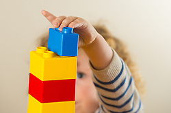 Embargoed to 2330 Wednesday June 28 File photo dated 24/01/16 of a preschool age child plays with plastic building blocks. A higher IQ in childhood is linked to a longer life, research suggests.