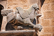 Griffin holding a decaptiated mans head on the faceade of the Basilica Church of Santa Maria Maggiore, Tuscania .<br /> <br /> Visit our ITALY PHOTO COLLECTION for more   photos of Italy to download or buy as prints https://funkystock.photoshelter.com/gallery-collection/2b-Pictures-Images-of-Italy-Photos-of-Italian-Historic-Landmark-Sites/C0000qxA2zGFjd_k .<br /> <br /> Visit our MEDIEVAL PHOTO COLLECTIONS for more   photos  to download or buy as prints https://funkystock.photoshelter.com/gallery-collection/Medieval-Middle-Ages-Historic-Places-Arcaeological-Sites-Pictures-Images-of/C0000B5ZA54_WD0s