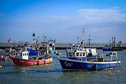 Fishing boats moored during high tide on 8th December 2018 in Folkestone Harbour, Kent, United Kingdom.