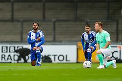 Josh Grant of Bristol Rovers takes a knee - Rogan/JMP - 30/11/2020 - FOOTBALL - Memorial Stadium - Bristol, England - Bristol Rovers v Darlington - FA Cup Second Round Proper.