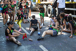 London, August 27 2017. Young ladies 'limber up' as Family Day of the Notting Hill Carnival gets underway. The Notting Hill Carnival is Europe's biggest street party held over two days of the bank holiday weekend, attracting over a million people. © Paul Davey.