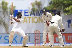 July 29, 2017 - Galle, Sri Lanka - Sri Lankan cricketer Dimuth Karunaratne plays a shot during the 4th Day's play in the 1st Test match between Sri Lanka and India at the Galle cricket stadium, Galle, Sri Lanka on Saturday 29 July 2017. (Credit Image: © Tharaka Basnayaka/NurPhoto via ZUMA Press)