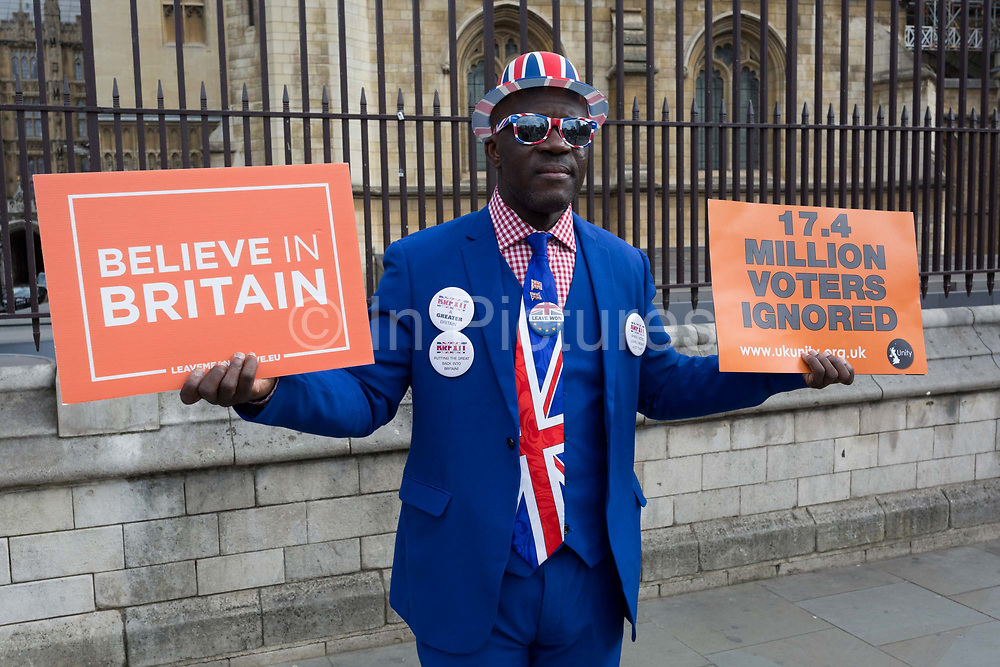 As MPs decide on how to progress with Brexit parliamentary procedure, a Leaver Brexiteer protests in front of railings outside the UK Parliament in Westminster, on 28th March 2019, in London, England.