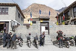 Heading back out on the road after a chai stop at the Himalayan Java Coffee House in Jomsom during Motorcycle Sherpa's Ride to the Heavens motorcycle adventure in the Himalayas of Nepal. On the fifth day of riding, we went from Muktinath to Tatopani. Friday, November 8, 2019. Photography ©2019 Michael Lichter.