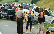 First responders tend to victims of a fatal collision on Hwy. 22 as a woman holds a crying baby that survived the crash.
