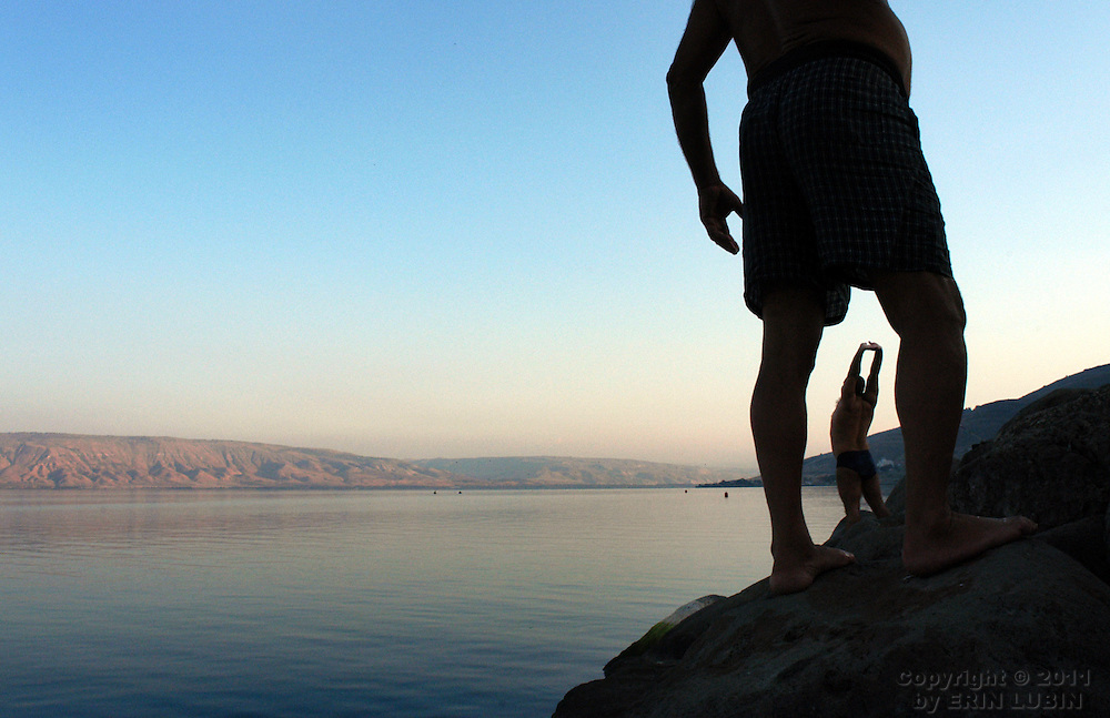Two Russian Jews prepare to jump into the Sea of Galilee in Tiberias, Israel on November 20, 2003. .Photo by Erin Lubin